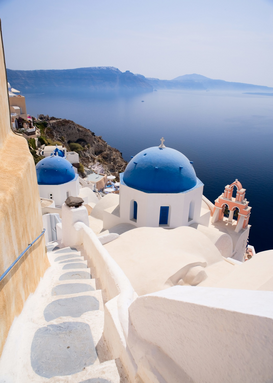 Pictures of famous buildings Wall Art as Canvas, Acrylic or Metal Print Blue domed church in Oia