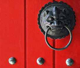 Pictures of doors & windows  Wall Art as Canvas, Acrylic or Metal Print Detail Image of a Chinese temple door with lion head door handle in Singapore.