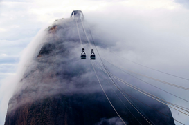 EyeEm Bilder z.B als Leinwandbild oder Wandbild hinter Acrylglas: Low Angle View Of Overhead Cable Cars On Sugarloaf Mountain Against Sky During Foggy Weather