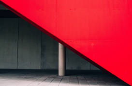 EyemEm Architectuur Foto's bijv. als canvasfoto of wandfoto achter acrylglas: Red Wall Over Sidewalk