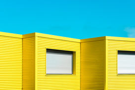 Editor′s Choice Pictures Wall Art as Canvas, Acrylic or Metal Print Yellow Buildings Against Clear Blue Sky