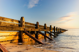Editor′s Choice Pictures Wall Art as Canvas, Acrylic or Metal Print Wooden Groyne At Beach Against Sky