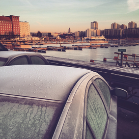 EyeEm Städte Bilder z.B als Leinwandbild oder Wandbild hinter Acrylglas: Close-Up Of Frozen Car Roof By Harbor Against City During Sunset
