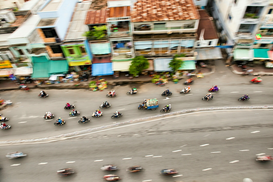 Foto: Städte - High Angle View Of People Riding Motorcycle On Road