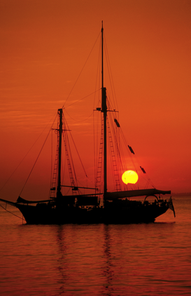 Sunset pictures Wall Art as Canvas, Acrylic or Metal Print Yacht at sunset.