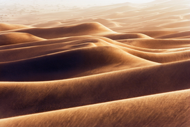 Foto: Woestijn - Dunes at Erg Awbari during sand storm