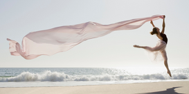 Staged photography Wall Art as Canvas, Acrylic or Metal Print Dancer leaping on beach
