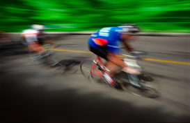Sports pictures Wall Art as Canvas, Acrylic or Metal Print Two cyclists racing on road