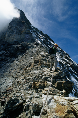 Extreme sports pictures Wall Art as Canvas, Acrylic or Metal Print Climber descending hornli ridge on matterhorn