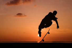 Extreme sports pictures Wall Art as Canvas, Acrylic or Metal Print Silhouette of a skateboarder jumping