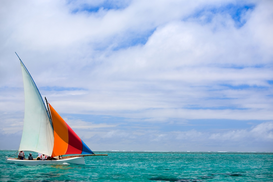 Water sports pictures Wall Art as Canvas, Acrylic or Metal Print Sailing regatta in Mauritius on colorful traditional wooden boats called Pirogue