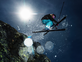 Winter sports pictures Wall Art as Canvas, Acrylic or Metal Print Female skier jumping over rock