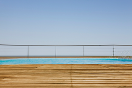Beach pictures Wall Art as Canvas, Acrylic or Metal Print Outdoor swimming pool with wooden deck