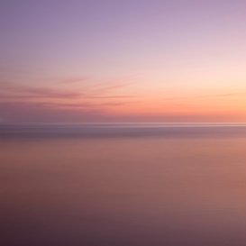Foto: Aan zee - Sunset over sea
