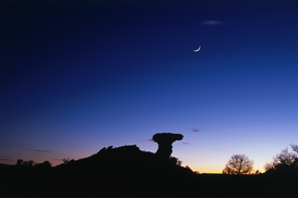 Space pictures Wall Art as Canvas, Acrylic or Metal Print Camel Rock silhouetted under a crescent moon just after sunset, Tesuque Pueblo.