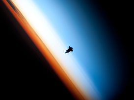 Space pictures Wall Art as Canvas, Acrylic or Metal Print ENDEAVOUR SPACE SHUTTLE STS-130 MISSION SILHOUETTED BY EARTH.