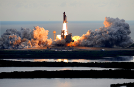 Stelle e pianeti Immagini ad esempio come immagine su tela o a muro dietro vetro acrilico: The Space Shuttle Endeavour Launches from Kennedy Space Center